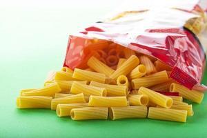Raw tortiglioni pasta bag pack photo