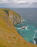 Steep Cliffs Leading to a Rocky Bay photo