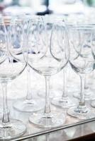 Many empty glasses in a line photo