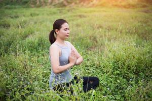Beautiful yoga woman in the prayer position. photo