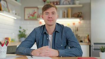 Young casual man blogger looking at camera speaking recording lifestyle vlog at home, happy millennial guy talking sharing news making video call dating communicating online photo
