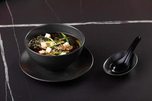 Miso soup, Japanese Food on black background photo