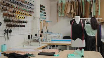 Tailor's workshop studio. Hanging clothes on a hanger. Dummy standing on seeker tailor on a hanger background. photo
