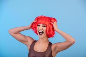 Portrait of beautiful sexy woman in red wig Bob hairstyle photo