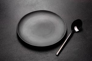 Set of tableware ready for the meal with black copy space photo