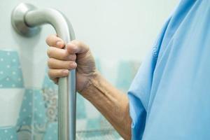 Asian senior woman patient use handle security photo