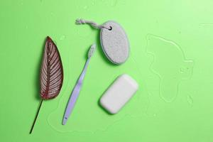 bath accessories and water on pastel background photo