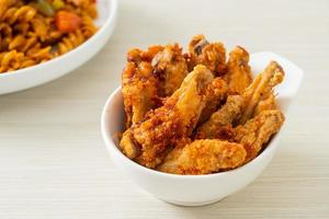 Fried barbecue chicken wings in white bowl photo