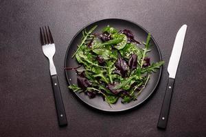 Healthy food, salad mix with arugula, spinach, bulls blood photo