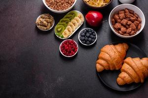 Delicious breakfast with fresh croissants and ripe berries photo