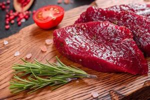 Fresh Raw Beef steak Mignon, with salt, peppercorns photo