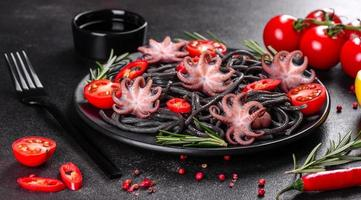 Black seafood pasta with shrimp, octopus and mussels photo