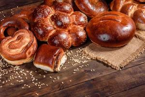 Composition of fresh baked sweet buns with poppy and jam photo