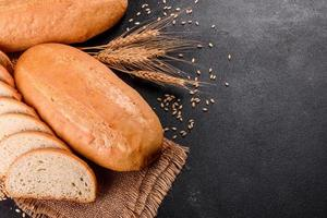 Fresh baked white bread on a brown concrete background photo