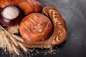 Fresh baked brown bread with coat of arms of Ukraine photo