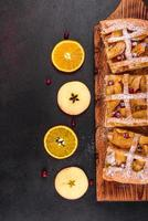 Delicious fresh pie baked with apple, pears and berries photo
