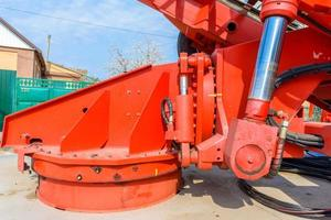 Hydraulic equipment of lifting crane with boom and basket for workers photo