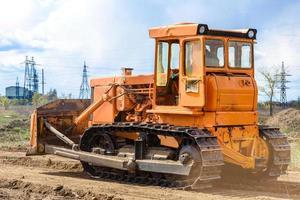 Industrial building construction site bulldozer photo
