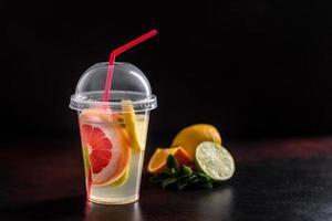 Hot fruit tea with lemon, mint, orange, lime and grapefruit photo