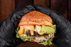 Tasty grilled homemade burger with beef, tomato, cheese photo