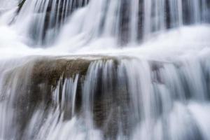 Waterfall flowing fall on limestone photo