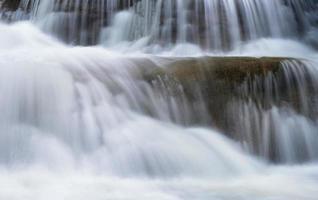 Waterfall flowing on limestone photo