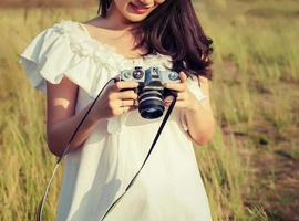Vintage of women photography standing hand holding retro camera. photo