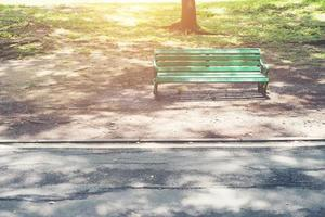 Green bench in the park. photo