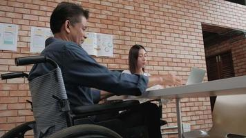 Disabled Business Man Meeting with Female Manager video