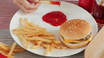 Eating Fast Foods on A White Dish video
