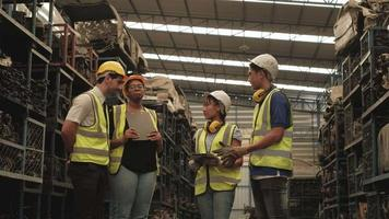 A Group of Workers in Safety Uniforms and Helmets in Warehouse video