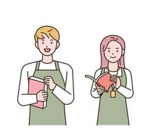 Bookstore employees wearing aprons are standing with smiles. vector