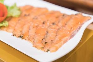 Smoked salmon on white plate photo
