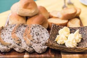 Mixed bread on dining table photo