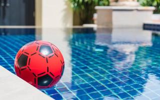 Inflatable colorful ball floating in a swimming pool photo