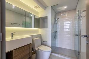 Clean and white Bathroom with Amenities in Luxurious Apartment photo