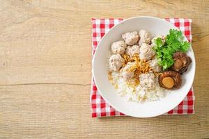 Dried Rice Porridge with Boiled Pork Bowl photo