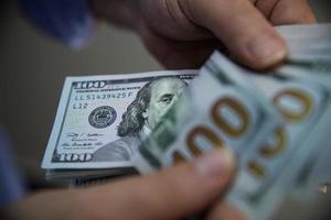 Close up of US 100 dollar bills photo