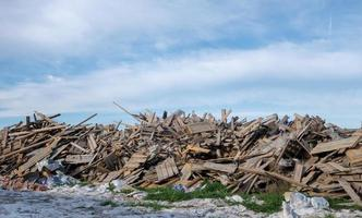 Large pile of broken boards used in construction, debris photo