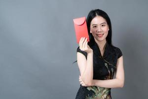 Asian woman wear Chinese traditional dress with red packet photo