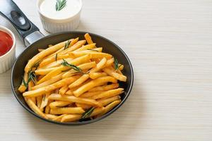 French fries with sour cream and ketchup photo