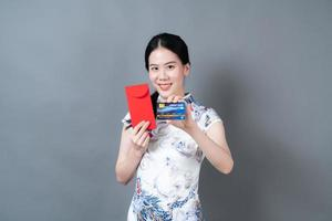 Asian woman wear Chinese traditional dress with red envelope photo