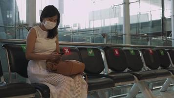 Travelers keep a social distance to prevent the spread of COVID-19. video