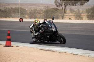 Motorcycle competition at a race track on a training day photo
