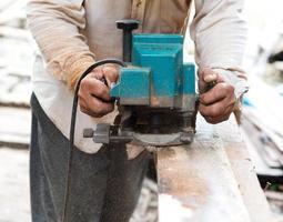 Man carpenter cutting wood photo