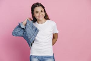 Casual, modern teenage girl wearing a denim jacket photo