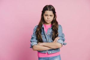 Sad girl on a pink background photo