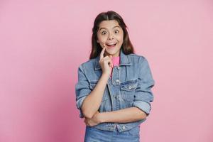 Cute, teenage girl in a denim jacket has a great idea photo