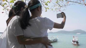 Mother and Her Daughter Posing for Selfie Photo Together at The Pier video