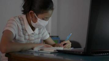 Girl Wears Face Mask During Study Lesson Online video